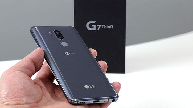 LG G7 ThinQ in hand with box back