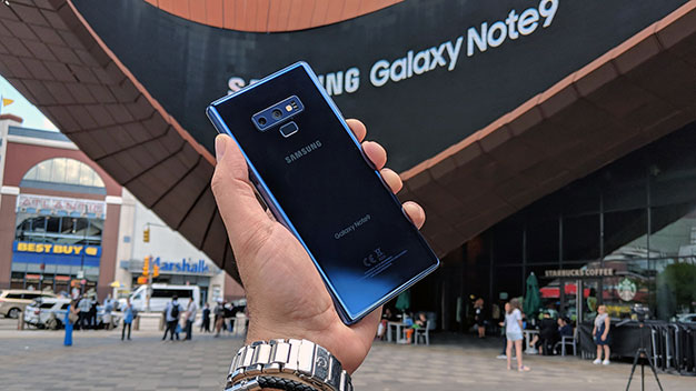 Samsung Galaxy Note 9 in hand at event