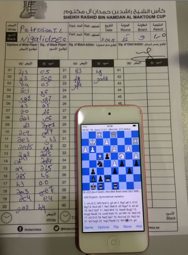 A Chess Grandmaster is facing a stiff penalty for allegedly cheating via an iPod Touch.