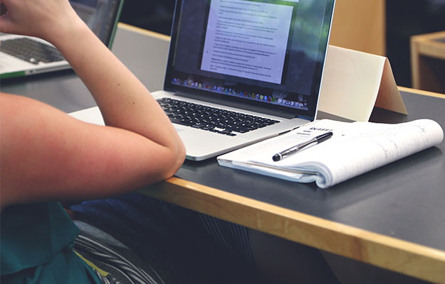 student with macbook