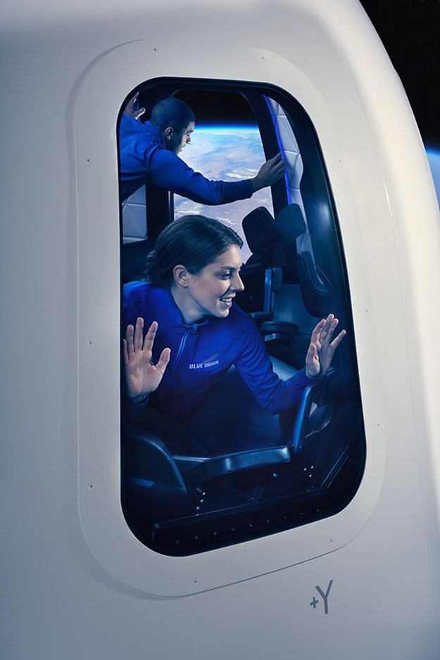 blue origin passenger looking out window