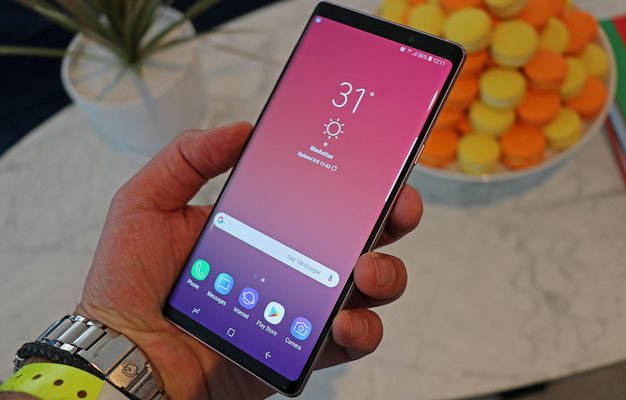 Galaxy Note 9 Purple front in hand man