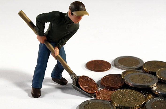 Man Sweeping Money
