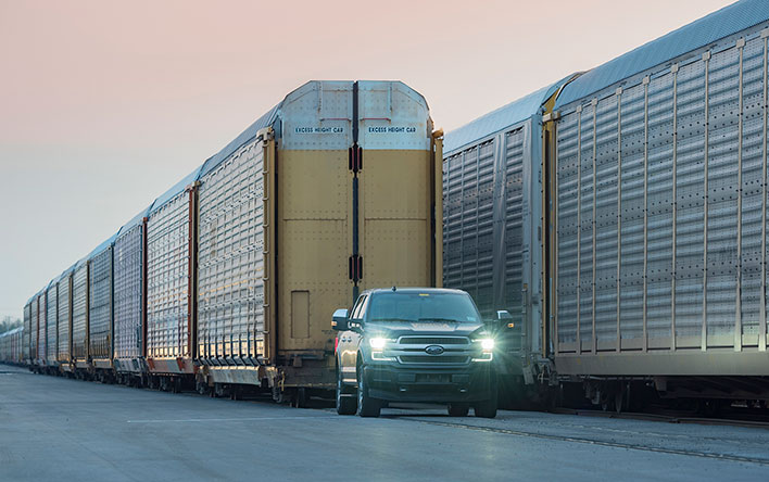 Ford All-Electric F-150 Pickup Truck Pulling a Train