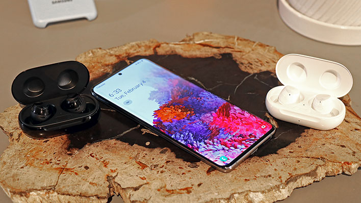 samsung galaxy s20 with buds on rock