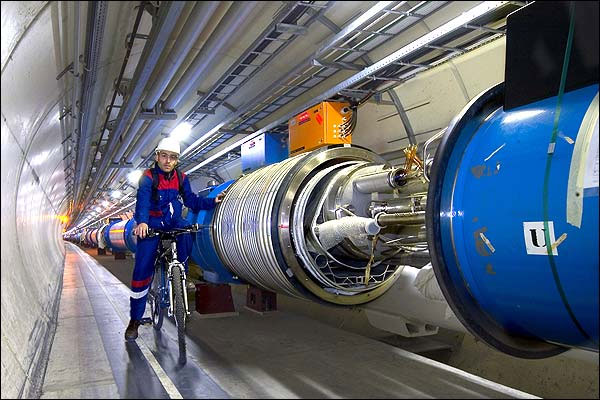 Scientists patrol the LHC, inspecting the damaged areas.