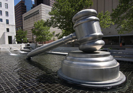 giant gavel, symbolic of the high-stakes tech patent wars